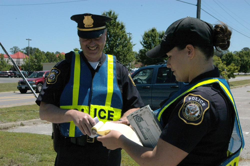 Two police officers writing citations
