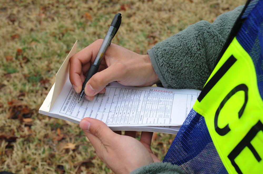 Police officer writing a citation